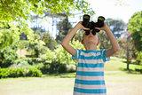 Cute little girl looking through binoculars