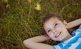 Cute little girl lying on grass