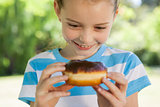 Cute little girl eating doughnut