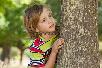 Little boy spying in the park