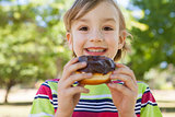 Little boy eating chocolate doughnut