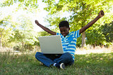 Cute little boy with laptop