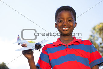 Little boy playing with toy airplane