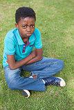 Sad little boy in the park