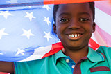 Happy boy in the park with american flag
