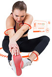 Composite image of fit brunette stretching her leg