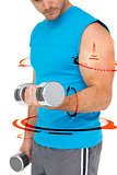 Composite image of mid section of a fit man exercising with dumbbells
