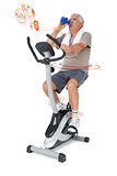 Composite image of senior man drinking water on stationary bike