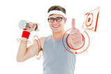 Composite image of geeky hipster posing in sportswear with dumbbell