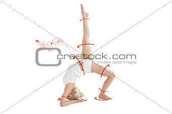 Composite image of sporty woman stretching body with raised leg