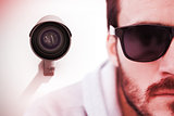 Composite image of close up of serious man wearing sunglasses