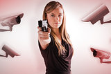 Composite image of femme fatale pointing gun at camera