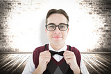 Composite image of smiling geeky hipster looking at camera