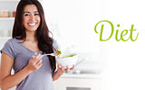 Diet against beautiful woman enjoying a bowl of salad while standing