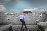 Composite image of anxious businessman under umbrella balancing