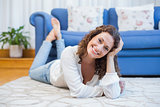 Smiling woman lying on the floor