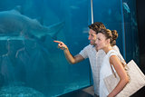 Happy couple looking at fish tank