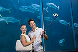 Happy couple using selfie stick