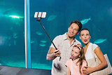 Happy family using selfie stick