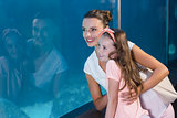 Happy family looking at fish tank