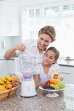 Mother and daughter making a smoothie