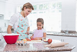 Mother and daughter baking together