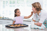 Mother and daughter with hot fresh cookies