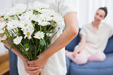 Daughter giving mother white bouquet