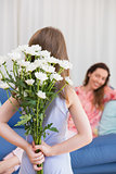 Daughter surprising mother with flowers