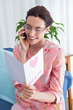 Mother reading a lovely card on phone call