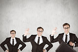 Composite image of nerdy businessman waving