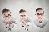 Composite image of nerdy businessman showing thumbs up