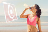 Composite image of beautiful healthy woman drinking water on beach