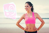 Composite image of beautiful smiling healthy with earphones on beach