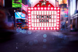 Composite image of neon coming soon sign