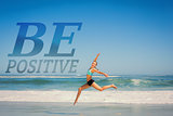 Composite image of fit woman jumping gracefully on the beach