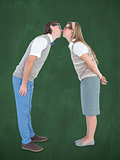Composite image of geeky hipster couple kissing