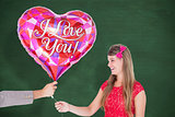 Composite image of geeky hipster offering red heart shape balloon to his girlfriend