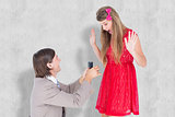 Composite image of hipster on bended knee doing a marriage proposal to his girlfriend