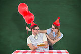 Composite image of geeky hipster couple celebrating his birthday