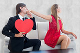 Composite image of cute geeky couple with red heart shape