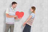 Composite image of geeky hipster giving heart card to his girlfriend