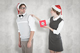 Composite image of geeky hipster offering present to her boyfriend