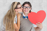 Composite image of smiling geeky hipster and his girlfriend