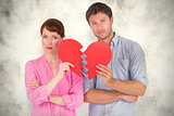 Composite image of couple holding a broken heart