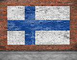 National flag of Finland painted on brick wall