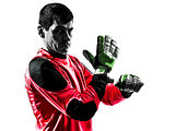 caucasian soccer player goalkeeper man adjusting gloves silhouet