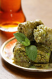 Turkish arabic dessert - baklava with honey and walnut, pistachios nuts