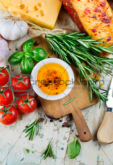 Olive oil with spices and cherry tomatoes