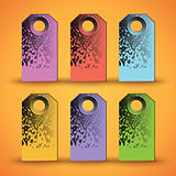 Set of the colorful tags on orange background.